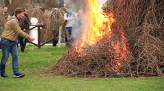The men poured gasoline firewood Stock Footage