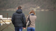 Boy and girl walking by the lake Stock Footage