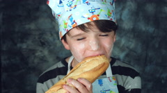 4k Colourful Shot of a Cook Child Biting and Eating Bread Stock Footage