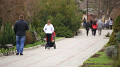 Parents walking with a pram. Stock Footage