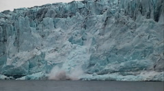 Ice falls from the face of a huge glacier. Stock Footage