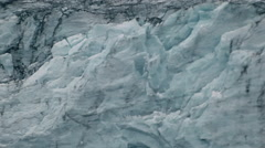 A single slab of ice plunges down a glacier into the water at the foot. Stock Footage