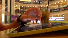 Hand gestures over tablet computer in cafe. Bokeh background 4K shot Stock Footage