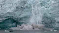 Massive slab of ice falls from the face of a glacier. Stock Footage