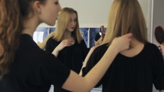 Group of pretty girls stands in front of mirror and smartens up for going out Stock Footage