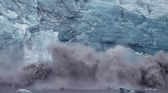 Massive chunks of the glacier's face turn loose and make dramatic splash. Stock Footage