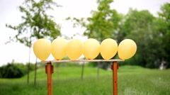 There was an arrow through six balloons Stock Footage