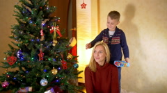 Son offering a gift to happy mother Stock Footage