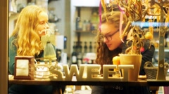 Two Girl Friends Talking in a Cozyart Cafe Drinking Coffee, Blonde and Brunette Stock Footage