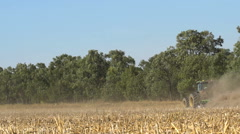 Tractor in the field with a harrow Stock Footage