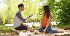 4k, Young attractive man proposes to his girlfriend while on a picnic. Stock Footage