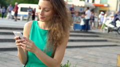 Happy girl texting messages on smartphone, steadycam shot, slow motion shot Stock Footage