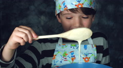 4k Colourful Shot of a Cook Child Looking at the Liquid for Pancakes Stock Footage