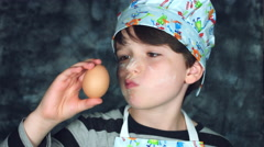 4k Colourful Shot of a Cook Child Checking and Analysing an Egg Stock Footage