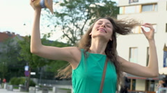 Happy girl going round and feeling free, steadycam shot, slow motion shot Stock Footage