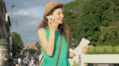 Happy girl talking on loudspeaker in the city, steadycam shot, slow motion shot  Stock Footage