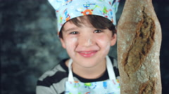 4k Colourful Shot of a Cook Child Showing Ciabatta Bread at Camera Stock Footage