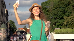 Happy girl going round while doing selfies on smartphone in the city Stock Footage