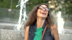 Girl laughing while pointing at something, steadycam shot, slow motion shot at 2 Stock Footage