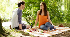 4k, An affectionate young couple having a picnic outdoors. Slow motion. Stock Footage