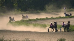 Horse racing in Slow motion. Jockeys run horses. Clouds of dust rise after rider Stock Footage