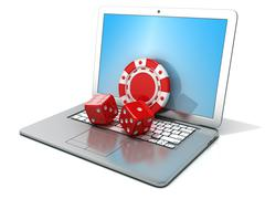 Laptop with red dice and chip. 3D Stock Illustration
