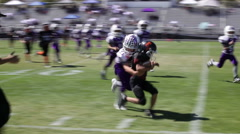 Run to right side, defense makes tackle at sideline at youth football game,3613 Stock Footage