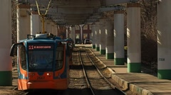 Tramway rush 71-623 arrives and departure the stop in Moscow Stock Footage