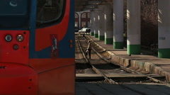 Tramway rush 71-623 arrives and 71-619 departure the stop in Moscow Stock Footage