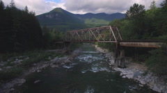 Aerial Shot of Rusty Old Train Bridge Over Skykomish River in Pacific Northwest Stock Footage