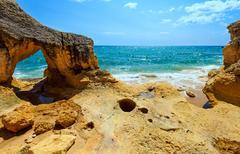 Atlantic rocky coast view (Algarve, Portugal). Stock Photos