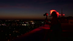 Backlit silhouette of the photographer on the roof with a camera Stock Footage
