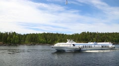 Tourist boat goes off the coast of the island of Valaam Stock Footage