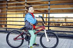 Young kid on cool bmx bicycle riding outside, lifestyle people concept Kuvituskuvat