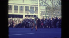 "1948: youth carries a sign in a parade introducing ""big ears the dope"" Stock Footage"