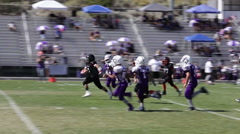 Football player with ball makes quick burst through the line for touchdown ,3618 Stock Footage