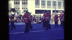 1948: marching band holds horns at the ready while marching in parade BALTIMORE, Stock Footage