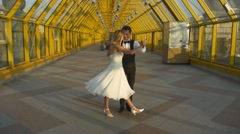 Man and woman dancing in sunlit hall Stock Footage