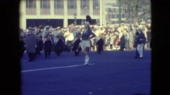 1948: marching band led down the street of a parade downtown city woman leads Stock Footage