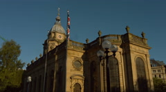 Birmingham Cathedral with Union Jack flag tracking shot early morning. 4K Stock Footage