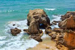 Atlantic rocky coast view (Algarve, Portugal). Stock Photos