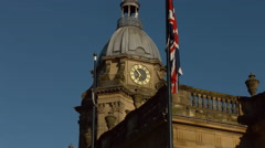 Birmingham Cathedral with Union Jack flag tracking shot early morning. MS 4K Stock Footage