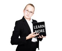 Beautiful school girl in a business suit holds a pc tablet in his hands and Stock Photos