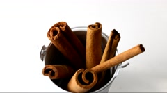 Cinnamon sticks rotating in a container Stock Footage