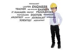 Boy with helmet writes his dream jobs Stock Photos