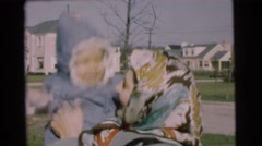 1951: woman bounces a baby in the middle of a neighborhood CHATHAM, NEW JERSEY Stock Footage