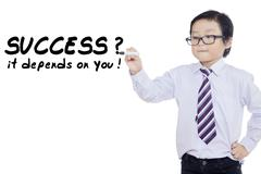 Child writes success depends on you Stock Photos