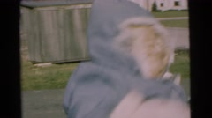 1951: happy mother bouncing happy baby outside in winter CHATHAM, NEW JERSEY Stock Footage