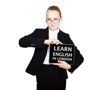 School girl in a business suit holds a pc tablet in his hands with inscription Stock Photos
