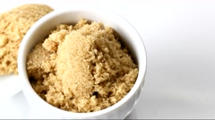 A container with brown sugar rotating on white background Stock Footage